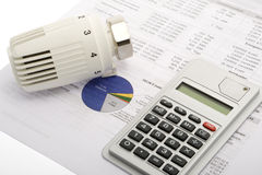 Energy costs. Accounting with thermostat and pocket calculator royalty free stock images