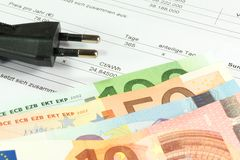 Energy costs and cash. Energy costs and Euro money royalty free stock photos