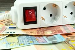 Energy costs and cash. Energy costs and Euro money stock images