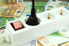 Energy costs and cash. Energy costs and Euro money stock photography