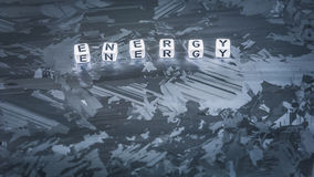 ENERGY cube letter on solar silicon cell surface. Concept of renewable clean energy royalty free stock photo