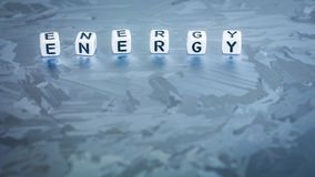 ENERGY cube letter on solar silicon cell surface. Concept of renewable clean energy stock images