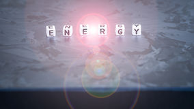 ENERGY cube letter on solar silicon cell surface. Concept of renewable clean energy. royalty free stock image