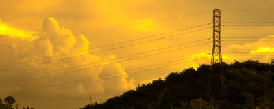 Transmission tower at sunset Stock Photo