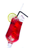 Energy drink cocktail with lime. Red Energy drink cocktail with lime royalty free stock photos