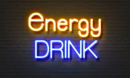 Energy drink neon sign on brick wall background. Stock Photo