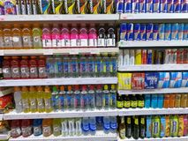 Energy Drink, Vitamin Water, Red Bull Cans in Supermarket stock image