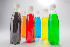 Energy drinks in colorful plastic bottles. Royalty Free Stock Photo