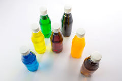 Energy drinks in colorful plastic bottles. Stock Photos