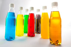 Energy drinks in colorful plastic bottles. Royalty Free Stock Images