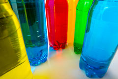 Energy drinks in colorful plastic bottles. Royalty Free Stock Photos