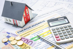 Energy efficiency certificate. House with money, calculator and an energy efficiency certificate royalty free stock images