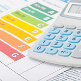 Energy efficiency chart and calculator - close up shot. Neat Energy efficiency chart and calculator - close up shot royalty free stock photos