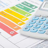 Energy efficiency chart and calculator - close up. Studio shot stock photos