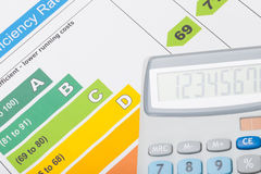 Energy efficiency chart and calculator over it - close up studio shot. Energy efficiency chart and calculator over it - close up shot stock photos