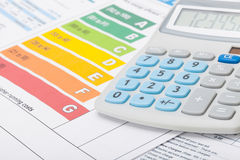 Energy efficiency chart with calculator - studio shot Stock Photography