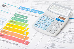 Energy efficiency chart and neat calculator - studio shot. Energy efficiency chart and neat calculator over it - close up shot royalty free stock image