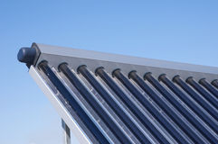 Energy efficiency concept. Closeup of vacuum solar water heating system on the house roof stock photo