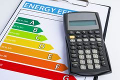Energy efficiency concept with energy rating chart. And calculator Royalty Free Stock Photography