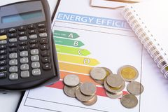 Energy efficiency concept with energy rating chart. And coin, calculator royalty free stock photos