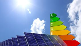 Energy efficiency graph next to a row of solar panels Stock Photo