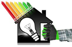 Energy Efficiency - Model House and Light Bulb. Energy Efficiency - Hand with work glove photo holding a symbol in the shape of house with energy efficiency royalty free stock photos