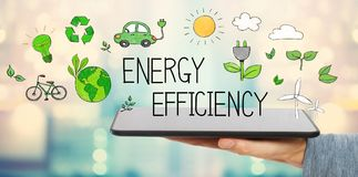 Energy Efficiency with man holding a tablet stock photography