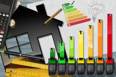Energy Efficiency Rating with Calculator and House royalty free stock photography