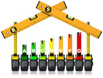 Energy Efficiency Rating - Tape Measures. Energy Efficiency Rating - Symbol with tape measures and spirit levels work tools in the shape of a house. Isolated on Royalty Free Stock Images