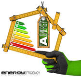 Energy Efficiency A - Ruler in the Shape of House. Energy Efficiency A - Hand with work glove holding a wooden folding ruler in the shape of house with energy Royalty Free Stock Photography