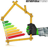 Energy Efficiency - Ruler in the Shape of House Royalty Free Stock Photo