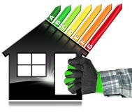 Energy Efficiency - Symbol in the Shape of House. Hand with work glove photo holding a black symbol in the shape of a house 3d illustration with energy Stock Photography