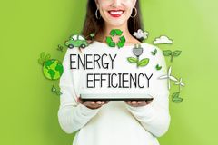 Energy Efficiency with woman holding a tablet. Computer royalty free stock photography
