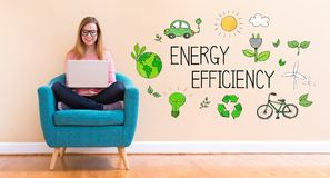 Energy Efficiency with young woman using her laptop. In a chair stock image