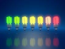Energy efficient. High Resolution 3d render of color light bulbs clipart on dark blue background Royalty Free Illustration