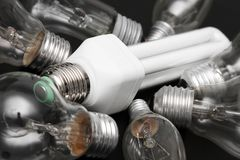 Energy efficient bulb in the middle of old incandescent Stock Image