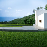 Energy efficient concrete modern house on the hill Stock Photo