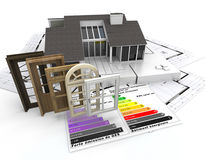 Energy efficient construction. Home construction concept with energy efficiency chart and a selection of doors and windows Royalty Free Stock Photography