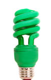 Energy efficient green light bulb Stock Images