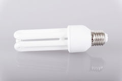 Energy efficient light bulb on gray background Royalty Free Stock Photography