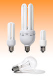 Energy Efficient Light Bulbs. Three energy-efficient fluorescent light bulbs of different power and a regular incandescent light bulb Power saving economy stock image