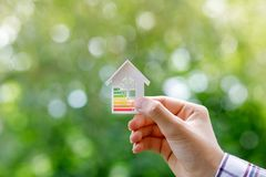 Energy efficient model house in hand . Energy efficient model house in hand on a blurred background royalty free stock image