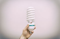 Energy efficient spiral-shaped fluorescent lamp. Stock Photo