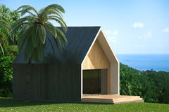 Energy efficient wooden house on the hill above the ocean Stock Image