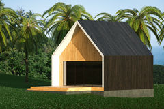 Energy efficient wooden house on the hill above the ocean Royalty Free Stock Photos