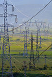 Energy. Electricity pylons and cables over landscape Royalty Free Stock Photos