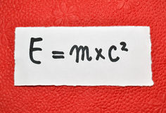 Energy equation. Famous physical formula on a vibrant red background royalty free stock images