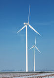 Energy farm. Image of a field with windturbines covered by snow in winter Stock Image