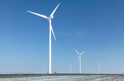 Energy farm. Image of a field with windturbines covered by snow in winter Stock Photography