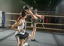 Energy female kick boxer practicing stock image